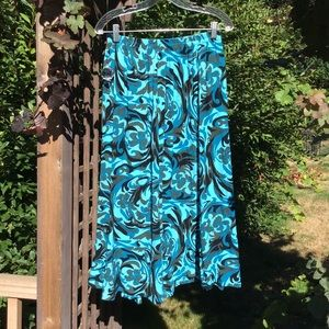 Dresses & Skirts - Turquoise floral camouflage-like pattern skirt